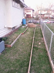 Reclaimed cedar decking makes for great raised beds. Bonus: there was already a rain barrel in the garage!